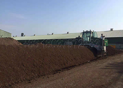Windrow turner for animal manure composting